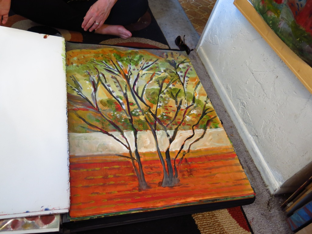 "Joyce Lieberman showing a piece from her ""Trees"" works on paper."